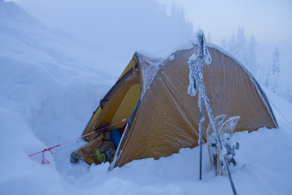 How to stake a tent in snow without tying knots