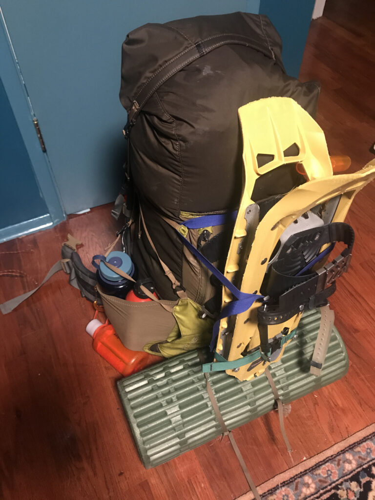 backpack with snowshoes attached