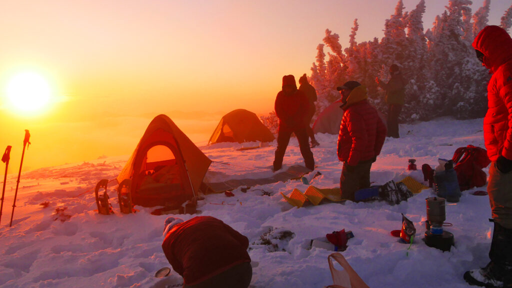 winter snow camp at sunset