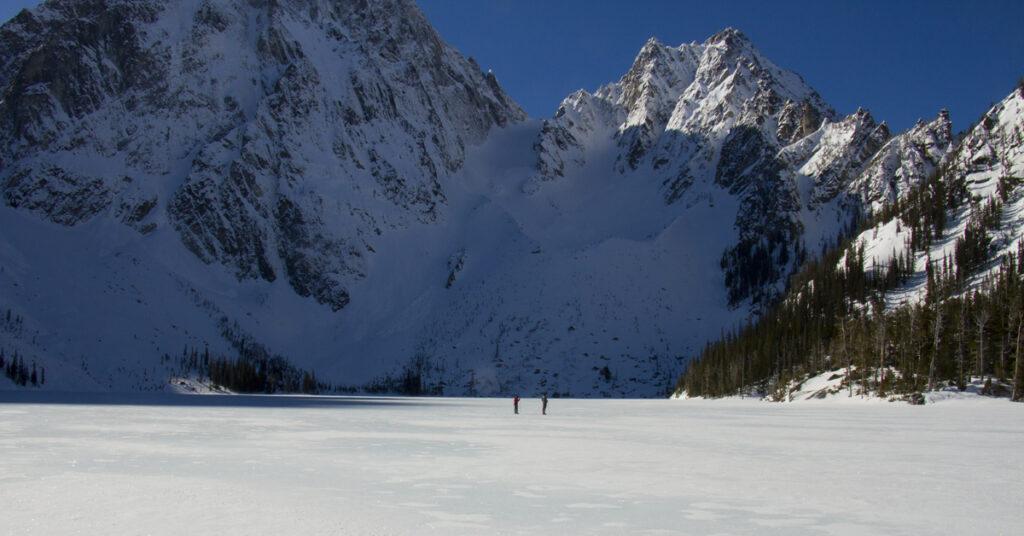 hiking on a frozen alpine lake