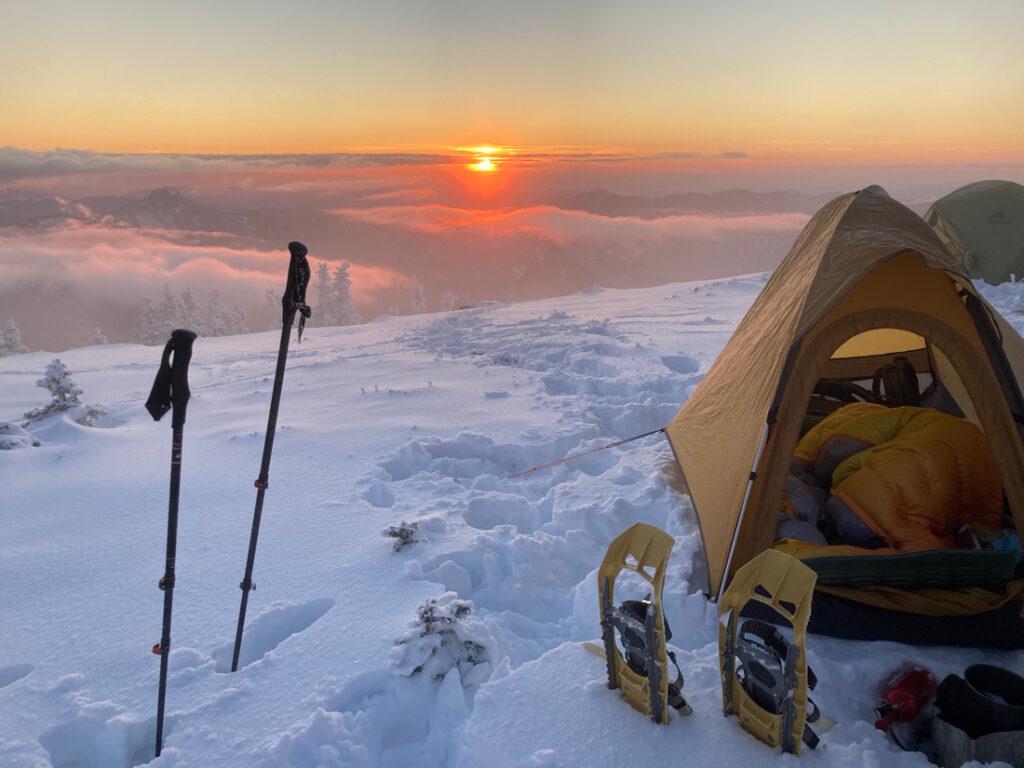 snow camp at sunset