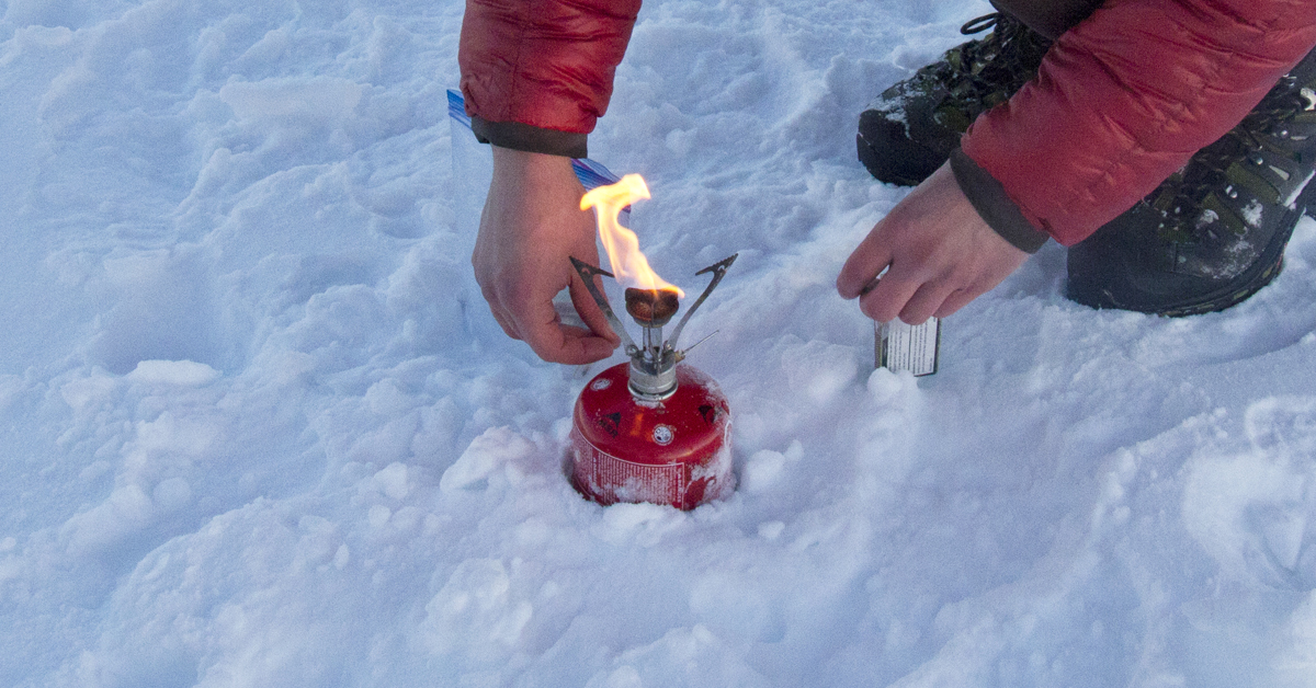 canister stove in snow